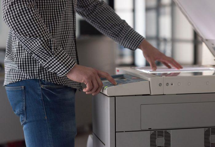 A man using a printer